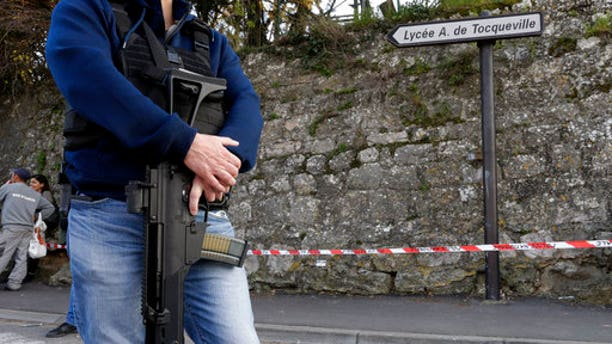 A police officer secures the area outside the Alexis de Toqueville high school.