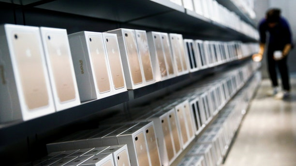 Apple's new iPhone 7 smartphones sit on a shelf at an Apple store in Beijing, China, Sept. 16, 2016. (REUTERS/Thomas Peter)