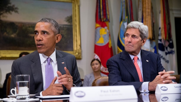 FILE - Sept. 10, 2015: President Obama, accompanied by Secretary of State John Kerry, meets with veterans and Gold Star Mothers to discuss the Iran Nuclear deal, in the Roosevelt Room at the White House in Washington.(The Associated Press)