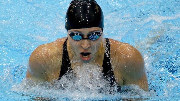 Ariana Kukors has accused a former U.S. Olympic Team swimming coach of sexually abusing her and taking explicit photos of her when she was underage.