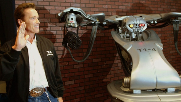 """U.S Actor Arnold Schwarzenegger, star of """"Terminator 3: Rise of the Machines,"""" poses before a news conference in Mexico City on July 24, 2003."""