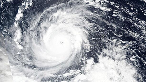 n this Wednesday, Sept. 12, 2018, NASA satellite image, Super Typhoon Mangkhut churns west towards the Philippines.