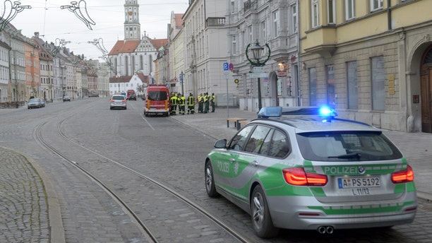 Dec. 25, 2016: A police vehicle drives through an almost empty street in Augsburg, Germany.