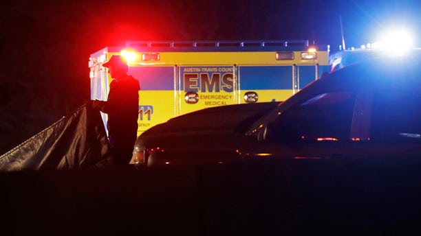 Officials work at the scene where the suspect in a spate of bombing attacks that have terrorized Austin over the past month blew himself up with an explosive device as authorities closed in, the police said early Wednesday, March 21, 2018.