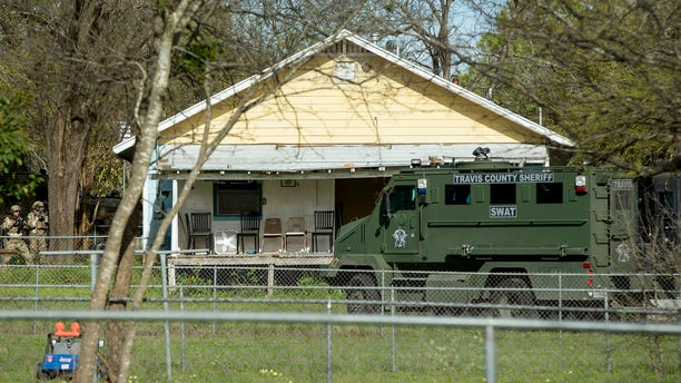 Authorities surround the home of the Austin bombing suspect Mark Conditt in Pflugerville, Texas, Wednesday, March 21, 2018.
