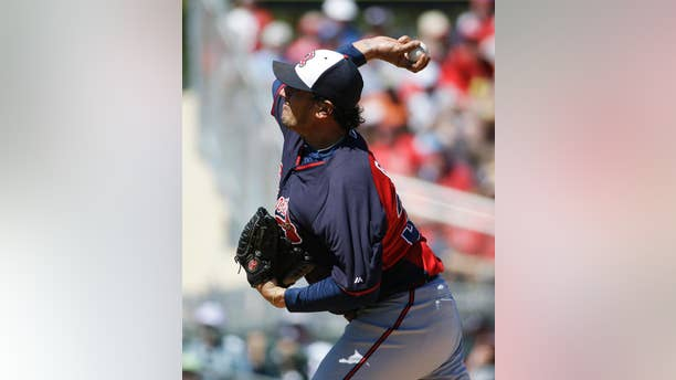FILE - IN this March 13, 2014 file photo, Atlanta Braves starting pitcher Freddy Garcia plays in an exhibition spring training baseball game against the St. Louis Cardinals in Jupiter, Fla.  Former All-Star pitcher  Garcia has joined Taiwan's EDA Rhinos and is set to become the highest-paid player in the local league's history.(AP Photo/David Goldman, File)