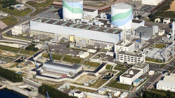 FILE - This Oct. 24, 2014 aerial photo shows two reactors at the Sendai Nuclear Power Station in Satsumasendai, Kagoshima prefecture, southern Japan. The nuclear plant on Wednesday, May 27, 2015 obtained the final permit needed to restart its reactors, paving the way for it to become the first to go back online under new safety standards introduced following the 2011 Fukushima disaster. The two reactors at the nuclear power station would mark the country's return to nuclear energy, as Prime Minister Shinzo Abe's pro-business government tries to put as many reactors back on-line as possible. (Kyodo News via AP, File) JAPAN OUT, CREDIT MANDATORY