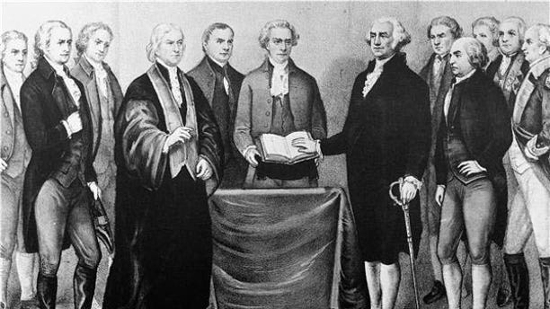 APRIL 30, 1789: This Currier and Ives print is a reproduction of the scene at Old City Hall in New York as George Washington took oath of office. Left to Right : in foreground, Alexander Hamilton; Chancellor Livingston who administered the oath; Roger Sherman; secretary Otis of the Senate; Washington; John Adams; Baron Stueben; and General Knox. (AP Photo)