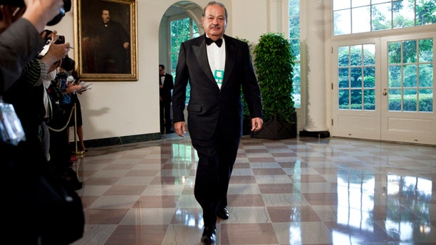 WASHINGTON - MAY 19:  Carlos Slim, Chairman and CEO of Telmex, Telcel and America Movil, arrives at the White House for a state dinner May 19, 2010 in Washington, DC.  President Barack Obama and first lady Michelle Obama are hosting Mexican President Felipe Calderon and his wife Margarita Zavala for a state dinner during their visit to the United States.   (Photo by Brendan Smialowski/Getty Images) *** Local Caption *** Carlos Slim
