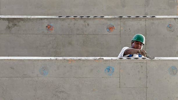 In this photo taken July 22, 2014, a construction worker is seen on a 36 floor high rise condominium in Miami. The Commerce Department reports on U.S. construction spending in July on Tuesday, Sept. 2, 2014. (AP Photo/Alan Diaz)