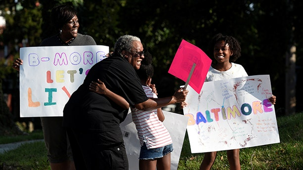 """People attend the """"Stop the Violence"""" rally at the intersection of Edmondson Avenue and Wildwood Parkway during the 72 hour community-led Baltimore Ceasefire against gun violence in Baltimore, Maryland, U.S. August 4, 2017. REUTERS/Sait Serkan Gurbuz - RTS1AGQQ"""