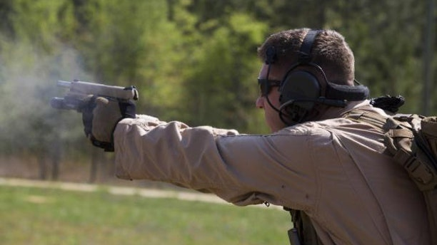 File photo - a U.S. Marine assigned to Force Reconnaissance Platoon, Maritime Raid Force, 26th Marine Expeditionary Unit (MEU), fires an M1911 MEUSOC .45-caliber pistol while conducting close quarters combat drills at Fort Pickett, Va., April 21, 2015. (U.S. Marine Corps photo by Lance Cpl. Andre Dakis/26th MEU Combat Camera/Released)