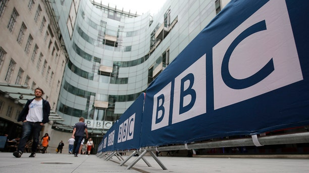 July 16, 2015: BBC workers place barriers near to the main entrance of the BBC headquarters and studios in Portland Place, London.