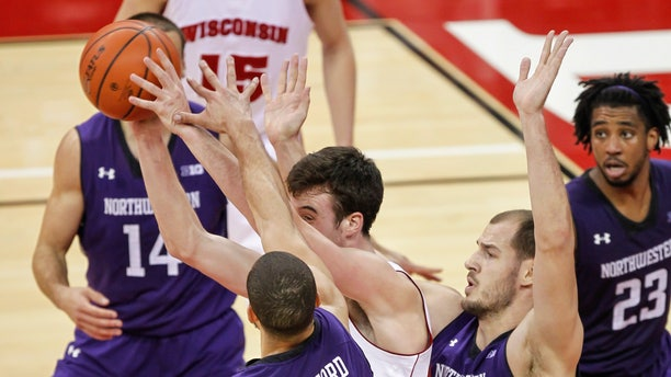 Northwestern's Drew Crawford (1) and Nikola Cerina (45) trap Wisconsin's Frank Kaminsky during the second half of an NCAA college basketball game Wednesday, Jan. 29, 2014, in Madison, Wis. Northwestern upset Wisconsin, 65-56. (AP Photo/Andy Manis)