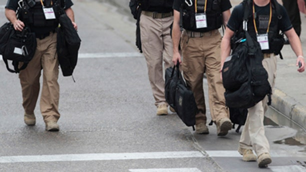 April 14, 2012: U.S. Secret Service agents walk around the Convention Center in Cartagena, Colombia, prior to the Summit of the Americas.
