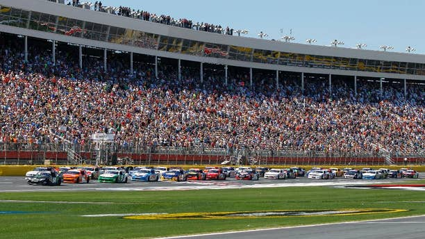 The field takes the green flag to start the NASCAR Nationwide series History 300 auto race at Charlotte Motor Speedway in Concord, N.C., Saturday, May 24, 2014. (AP Photo/Terry Renna)