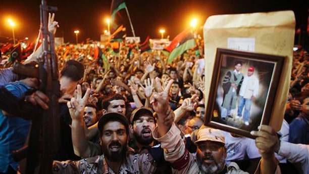 Monday: People celebrate the capture in Tripoli of Muammar al-Qaddafi's son and one-time heir apparent, Seif al-Islam, at the rebel-held town of Benghazi, Libya. The celebration was premature, however, as Seif al-Islam appeared in Tripoli Monday night to corral regime supporters.