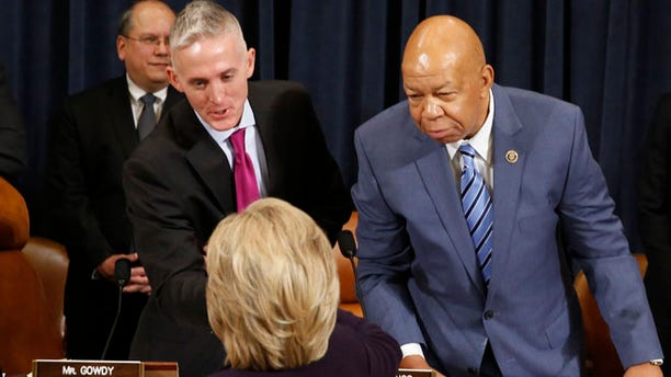 Oct 22, 2015: Democratic presidential candidate Hillary Clinton shakes hands with Committee Chairman Trey Gowdy (C) as ranking member Rep. Elijah Cummings (R) looks on as she arrives to testify before the House Select Committee on Benghazi about the attack on a U.S. diplomatic mission in Benghazi, Libya, on Capitol Hill in Washington.
