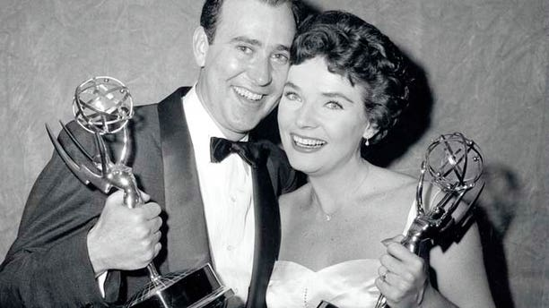 April 15, 1958: Writer Carl Reiner and actress Polly Bergen pose with their statuettes at the Emmy Awards presentations in New York.  (AP)
