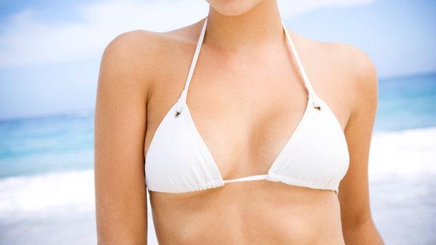 A young woman on the beach in a bikini