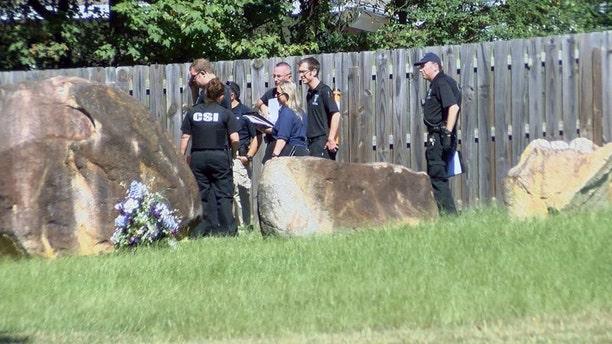Investigators search the area where Ashanti Billie's body was found Friday morning in Charlotte.