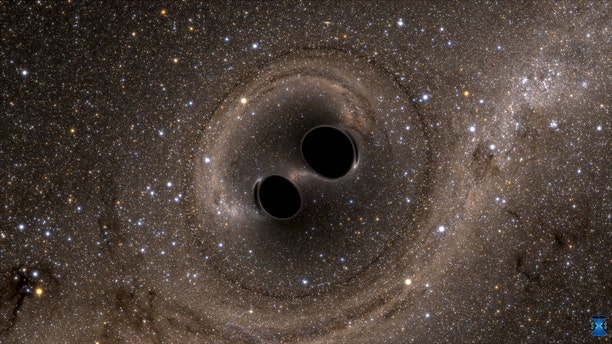 File photo: The collision of two black holes - a tremendously powerful event detected for the first time ever by the Laser Interferometer Gravitational-Wave Observatory, or LIGO - is seen in this still image from a computer simulation released in Washington February 11, 2016. (REUTERS/The SXS (Simulating eXtreme Spacetimes)/Handout via Reuters)