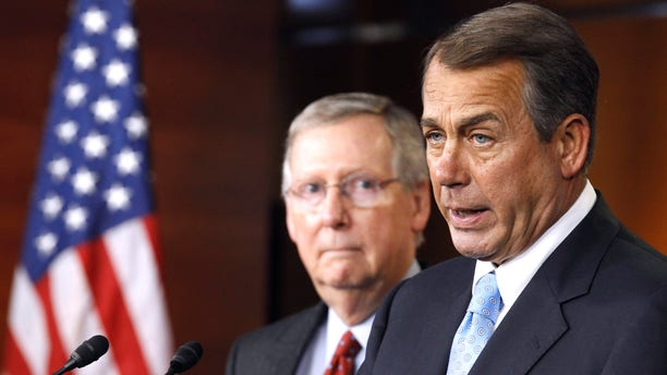 House Speaker John Boehner of Ohio, right, accompanied by Senate Minority Leader Mitch McConnell of Ky. speaks during a news conference on Capitol Hill in Washington, Wednesday, March 2, 2011. (AP)