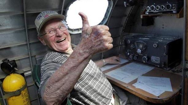 July 11, 2013: Joseph Dreher, Jr., gives a thumbs-up to a crew member of Sentimental Journey, a B-17 vintage bomber, after a beautiful takeoff from Lost Nation Airport in Willoughby, Ohio.