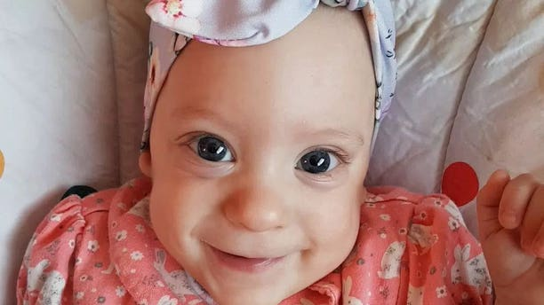 One-year-old Hailie survived her collapsed lung and is now a healthy baby girl.