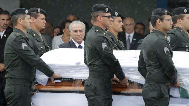 Dec. 3, 2016:  President Michel Temer attends the arrival ceremony of the coffins with the remains of Chapecoense soccer team victims, in Chapeco, Brazil.