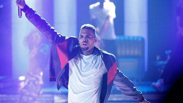 Chris Brown could get jail time over a lack of a permit for a pet monkey. Brown is shown performing at the BET Awards in Los Angeles last year.