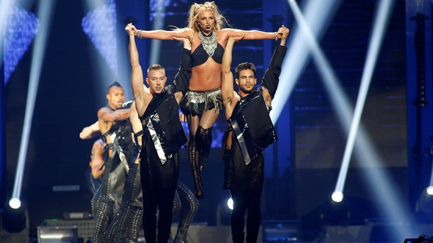 Britney Spears (C) performs with dancers during the iHeartRadio Music Festival at The T-Mobile Arena in Las Vegas, Nevada, U.S. September 24, 2016.