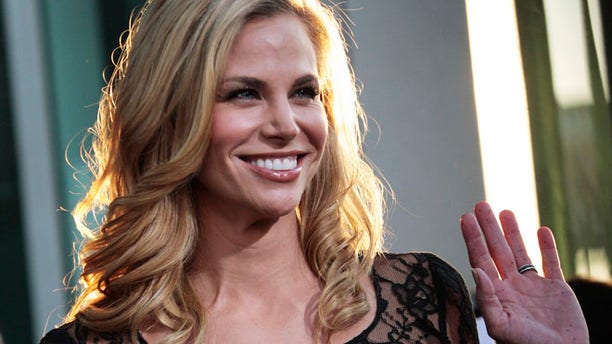 """Actress Brooke Burns arrives at the film premiere of """"Warrior"""" in Hollywood, California, September 6, 2011. REUTERS/Jason Redmond  (UNITED STATES - Tags: ENTERTAINMENT) - RTR2QWC7"""