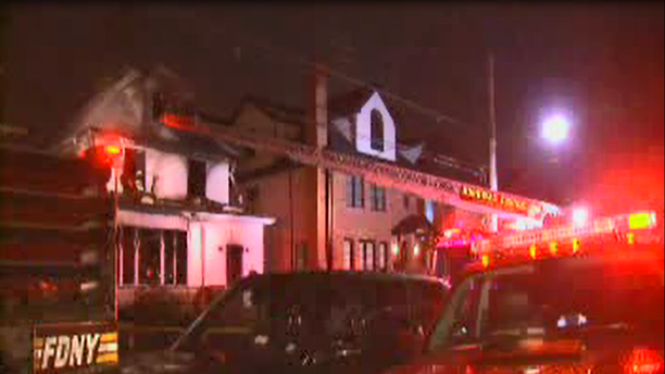 "Fire broke out at the Brooklyn home about 2:15 a.m., leaving most of the building ""heavily damaged,"" officials said."