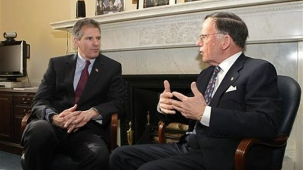 Sen.-elect Scott Brown, left, meets with Sen. Paul Kirk, the interim senator for Massachusetts, on Capitol Hill Jan. 21. (AP Photo)