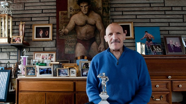 Bruno Sammartino sits in front of pictures, panitings and trophies highlighting his storied career as a wrestler and weightlifter, at his home in his North Hills, Pa., home, March 27, 2013.