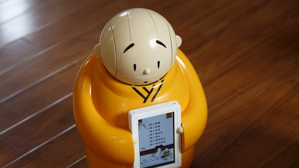 Robot monk Xian'er is pictured during its demonstration for a photo opportunity at Longquan Buddhist temple on the outskirts of Beijing, April 20, 2016. (REUTERS/Kim Kyung-Hoon)
