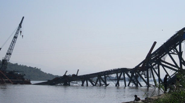 Nov. 11, 2012: A bridge under construction across the Irrawaddy River, east of Shwebo, Myanmar is seen collapsed after a strong earthquake.