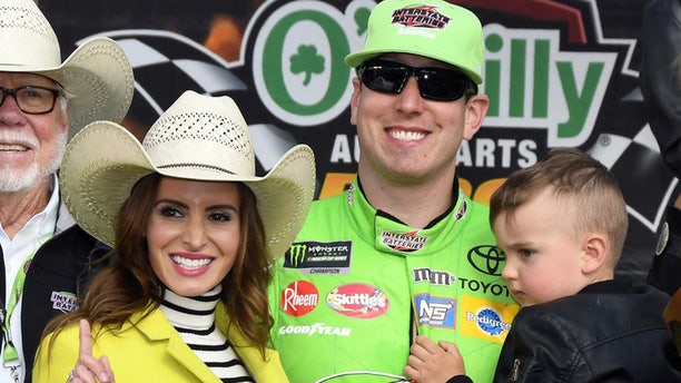 Samantha, Kyle and son Brexton Locke celebrate Busch's April win in Texas.