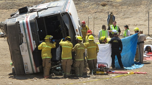 May 21: Emergency personnel respond to the scene of a fatal accident in Blythe, Calif. A tractor-trailer spilled a load of steel pipes onto a highway, triggering a bus crash Wednesday that killed four people and seriously injured several others on the main road linking Southern California and Arizona, authorities said.