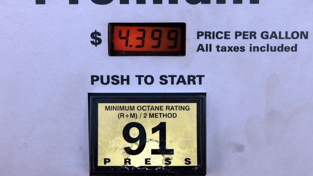 File-This Jan. 18, 2008, file photo shows the full service price per gallon of Premium gasoline  at a pump at a gas station in Berverly Hills, Calif. There is no sense paying a premium for premium gasoline if your car is designed to run on regular, according to research by the automobile club AAA.  (AP Photo/Damian Dovarganes, File)