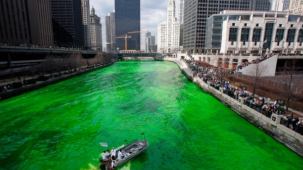 File photo: Workers dye the Chicago River green as part of the city's annual St. Patrick's day celebrations in Chicago March 11, 2006. (REUTERS/John Gress)