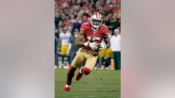 FILE - In this Jan. 12, 2013 file photo, San Francisco 49ers wide receiver Michael Crabtree (15) runs against the Green Bay Packers in an NFC divisional playoff NFL football game in San Francisco. The team's top wide receiver from 2012 is back on the active roster six months after Achilles tendon surgery and poised to make his season debut Sunday against St. Louis if all goes as hoped during practice this week. (AP Photo/Tony Avelar, File)