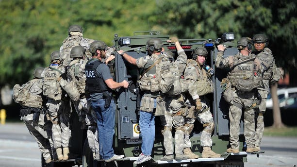 Dec. 2, 2015 - A SWAT vehicle carries police officers near the scene of the shooting in San Bernardino, Calif. (AP)