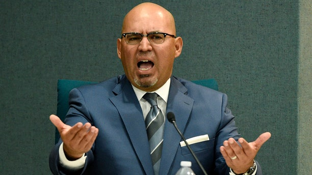 Pico Rivera, Calif., City Councilman and El Rancho High School teacher Gregory Salcido addresses the public during a city council meeting at Pico Rivera City Hall on Tuesday.