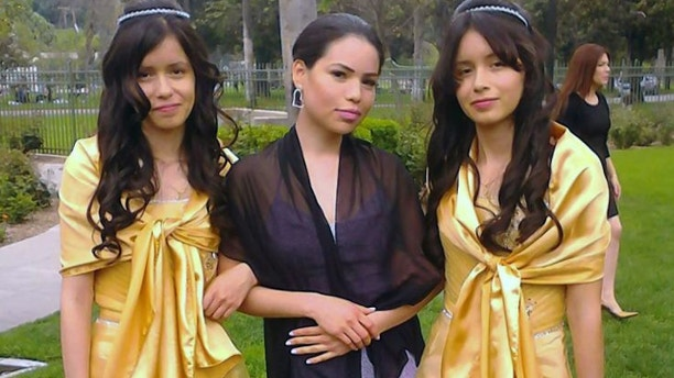 UNDATED: This 2013 photo provided by Miguel Serrato shows twin sisters Marisol Serrato, 17, left, and Marisa Serrato, right, with their sister-in-law Ivette Serrato during a wedding in Riverside, Caif.