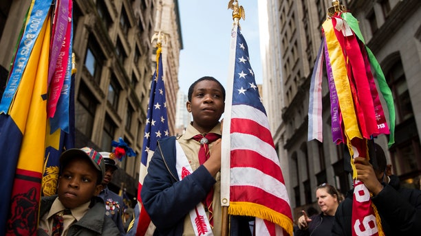 Nov. 11, 2014: Members of the Boy Scouts wait to march in the Veterans Day parade on 5th Avenue in New York.