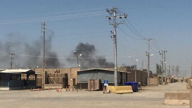 The U.S. Army soldier that provided the photos says that the pits are about 400 yards from thier barracks and that the smoke often hangs over their section of the base.