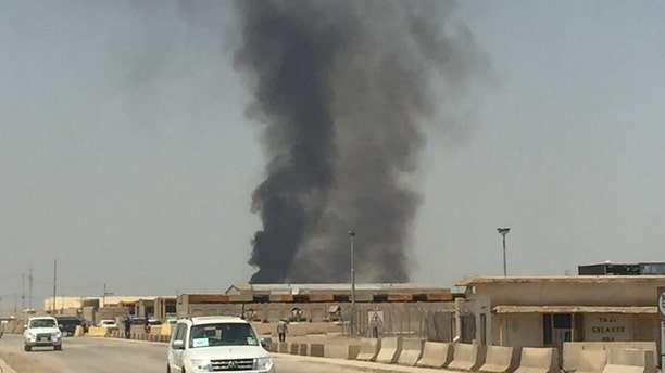In a series of images provided to Fox News, burn pits are seen still in operation near Camp Taji, Iraq.
