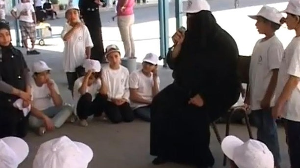 A camp instructor at a UN-affiliated youth camp in Gaza tells kids it is their duty to take back Israel.